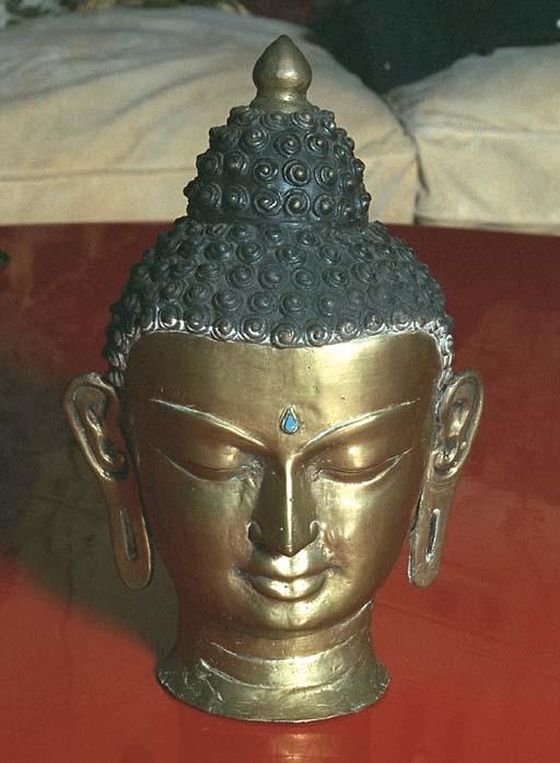 A Nepalese Brass Head of Buddh