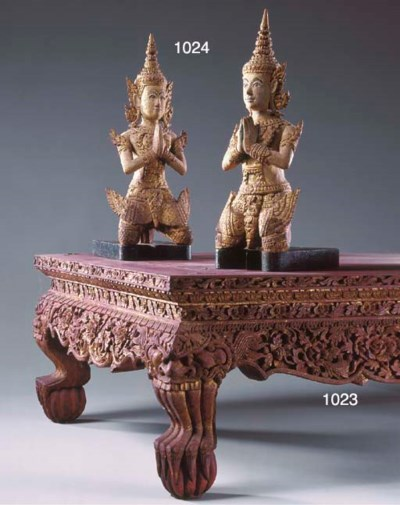 A Pair of Thai-Painted Wood Fi