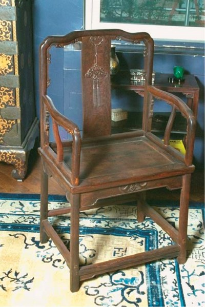 A CHINESE HARDWOOD ARMCHAIR