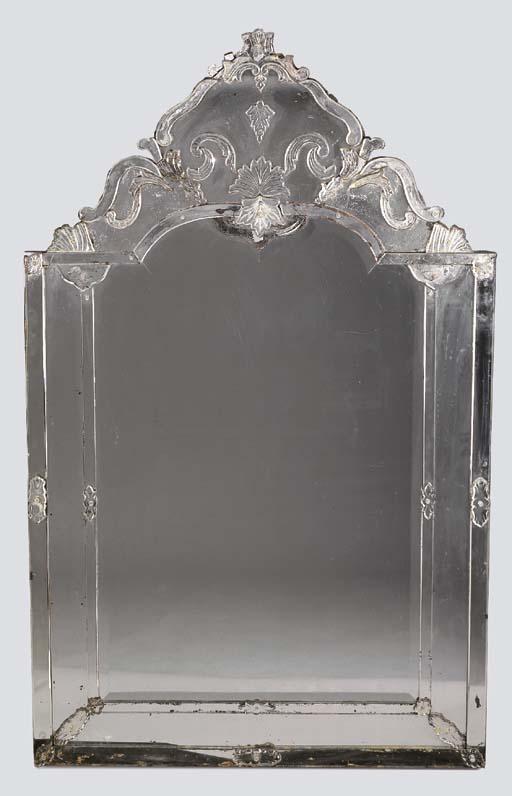 AN ITALIAN GLASS MIRROR