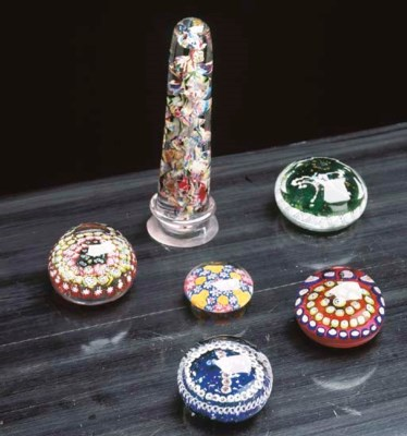 A GROUP OF GLASS PAPER WEIGHTS