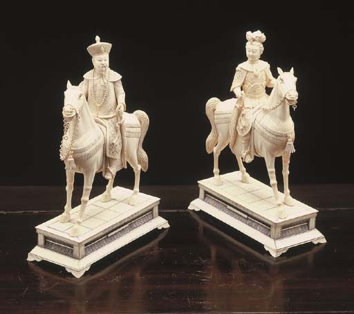A PAIR OF CHINESE CARVED IVORY