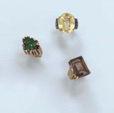 A GROUP OF FOUR RINGS