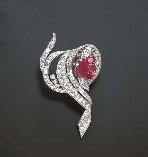 A DIAMOND AND RUBY BROOCH