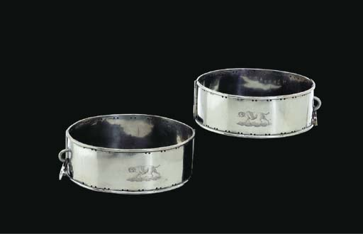 A PAIR OF SILVER-PLATED DOG CO