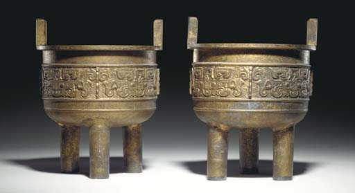 A PAIR OF CHINESE GILDED CAST-