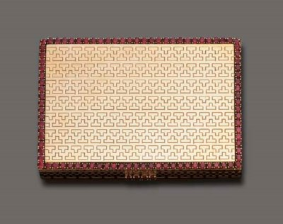 A GOLD AND RUBY VANITY CASE