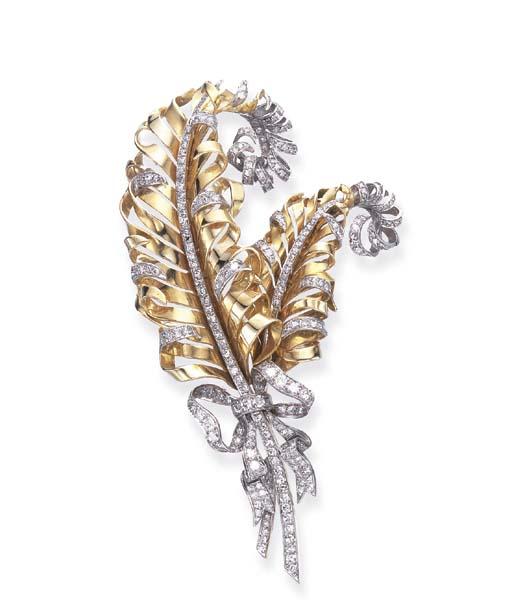 A RETRO DIAMOND AND GOLD FEATH