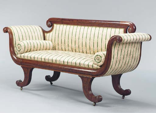 A CLASSICAL CARVED MAHOGANY AN