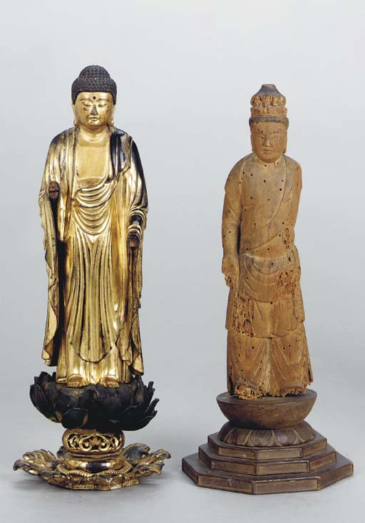 A CARVED GILTWOOD FIGURE OF BU