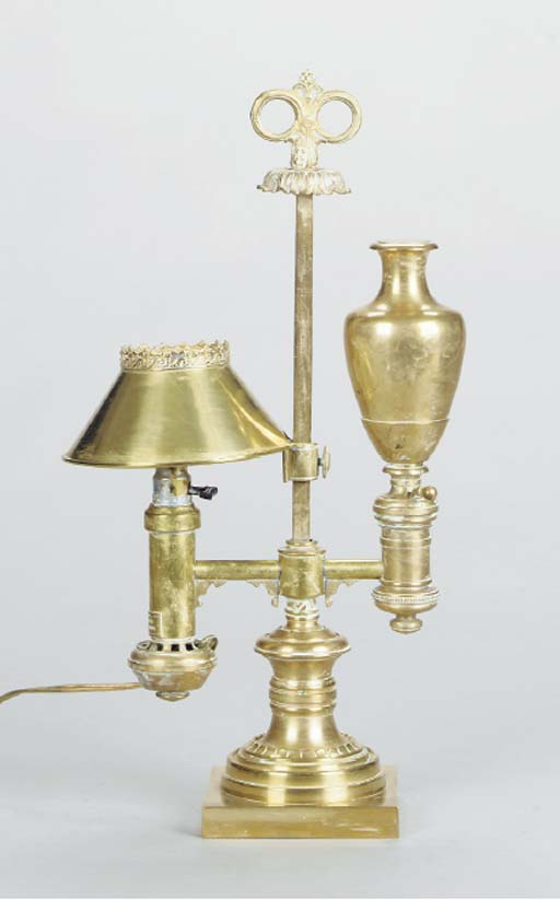 A BRASS ADJUSTABLE FLUID LAMP,