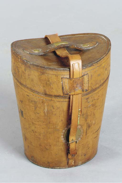 A LEATHER TRAVELING HAT BOX TO