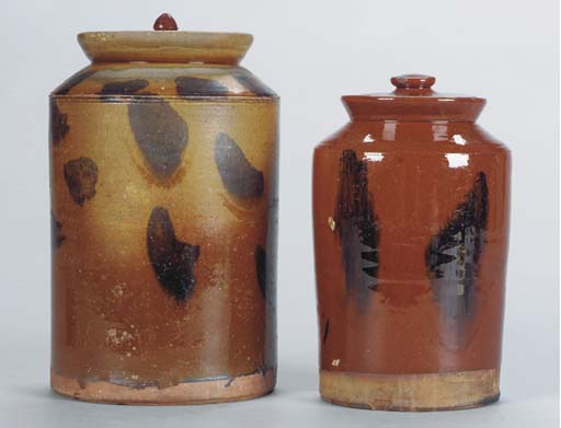 A GROUP OF EARTHENWARE RED-GLA