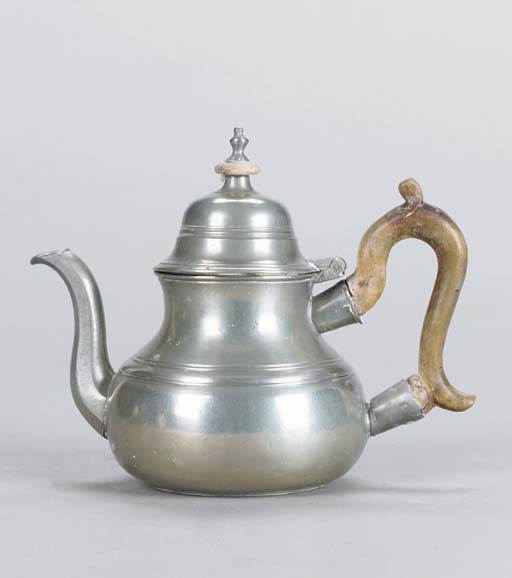 A PEWTER PEAR-SHAPED TEAPOT