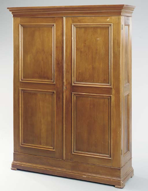 A WALNUT PANELED-DOOR WARDROBE