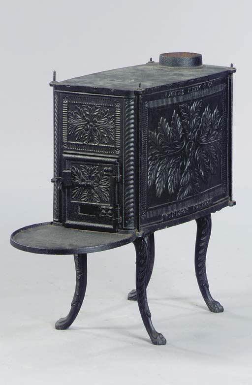 A CAST IRON STOVE TOGETHER WIT