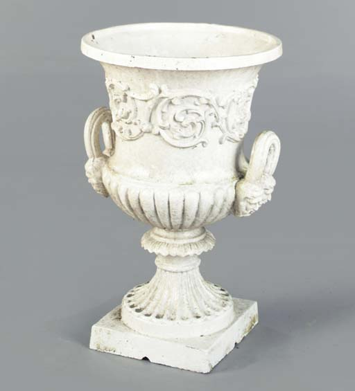 A WHITE PAINTED CAST IRON GARD