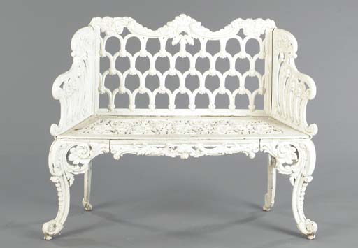 A WHITE PAINTED CAST IRON BENC