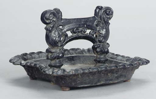 A GROUP OF CAST IRON HOUSEHOLD
