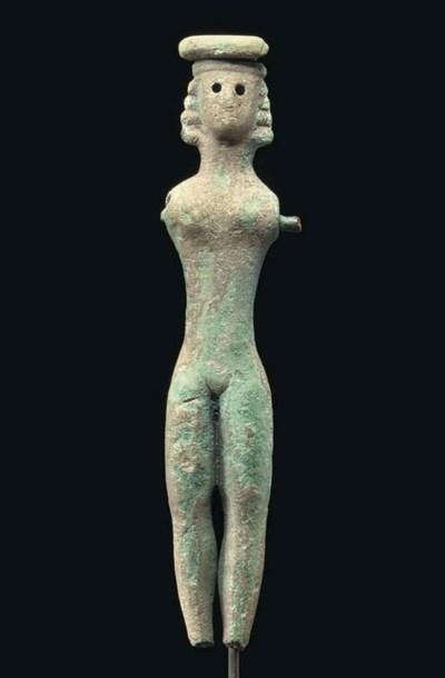 A GREEK BRONZE FEMALE FIGURE