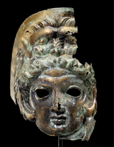 A GREEK BRONZE MASK OF HERAKLE