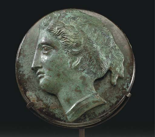 A GREEK BRONZE MIRROR COVER