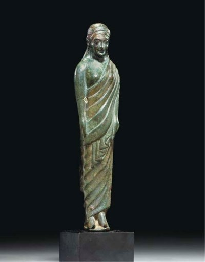AN ETRUSCAN BRONZE DRAPED WOMA