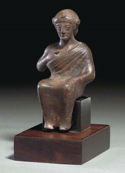 AN ETRUSCAN BRONZE SEATED YOUT