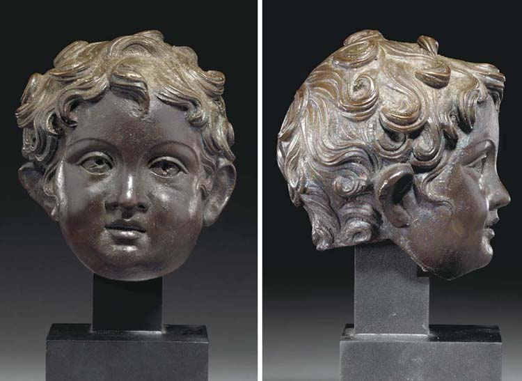 A ROMAN BRONZE HEAD OF A YOUNG