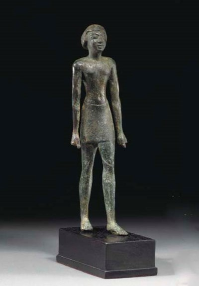 AN EGYPTIAN COPPER OFFICIAL