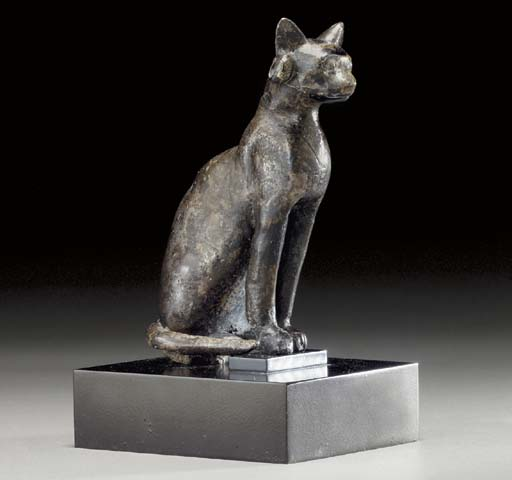 AN EGYPTIAN SILVER CAT
