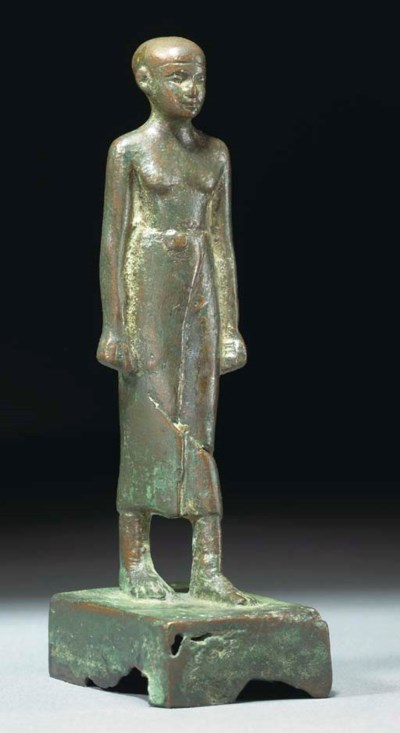 AN EGYPTIAN BRONZE MALE FIGURE