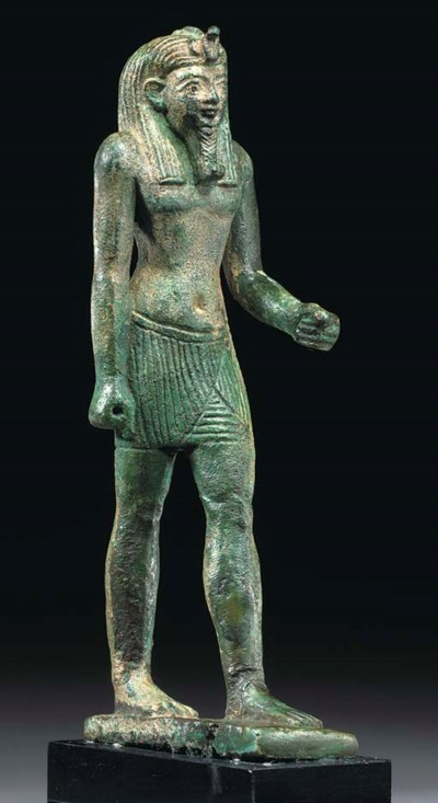 AN EGYPTIAN BRONZE STRIDING MA