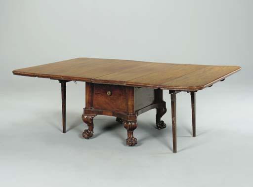 A REGENCY MAHOGANY EXTENSION DINING TABLE,