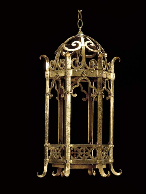 A PAIR OF GOTHIC REVIVAL HAMMERED BRASS HALL LANTERNS