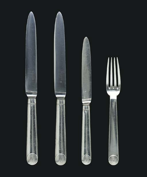 A group of flatware from the S