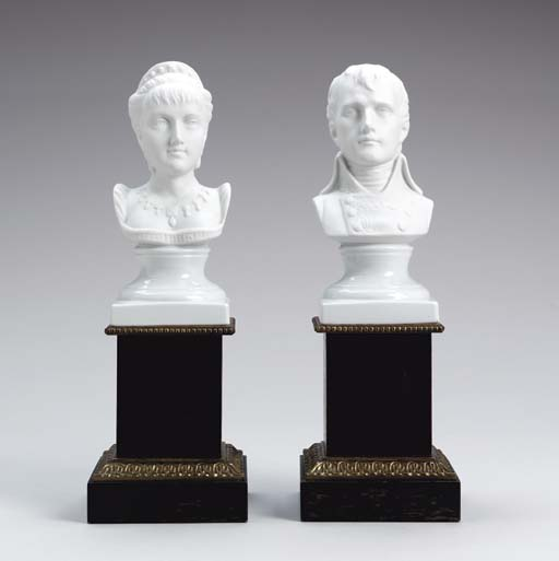 A PAIR OF BISCUT PORCELAIN POR