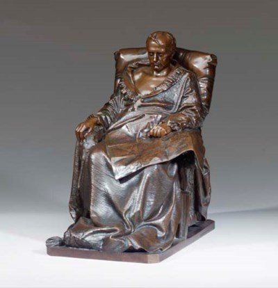 A PATINATED BRONZE FIGURE OF T