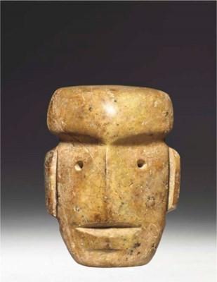 A LARGE MEZCALA STONE HEAD, TY