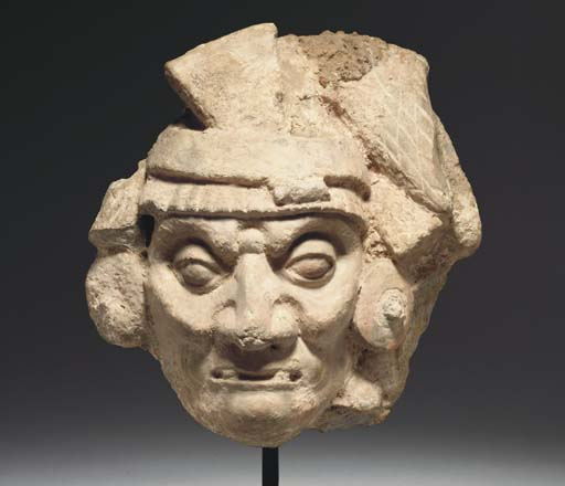 A MAYAN STUCCO HEAD OF GOD L