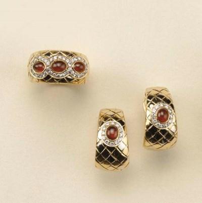 Demi parure in oro con rubini