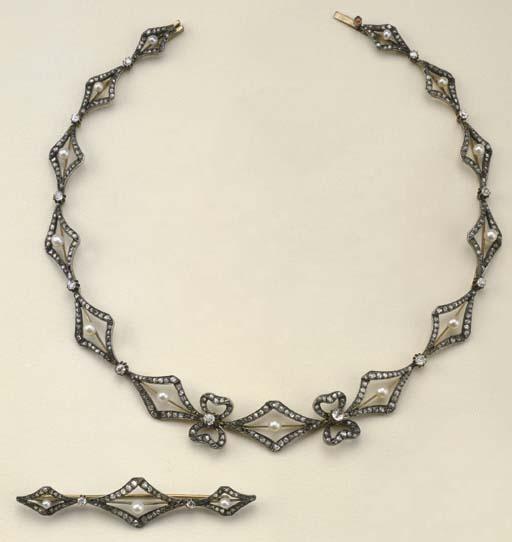 Antica demi parure in argento