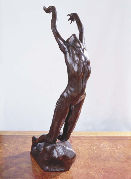 A BRONZE FIGURE OF A NAKED MAN