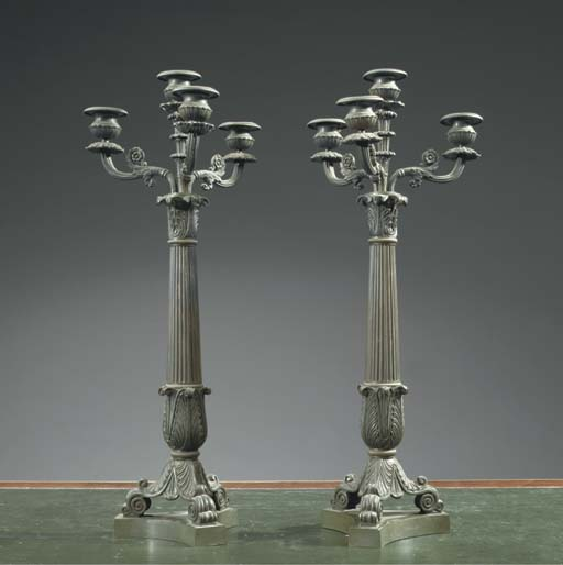 A pair of French patinated bronze four-light candelabra