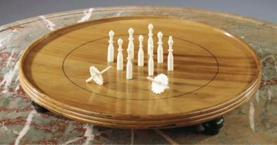 A cherrywood and ivory game