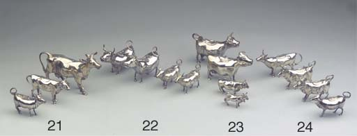 Four various silver cow-creamers