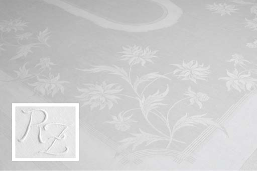 Two damask linen tablecloths and eighteen menue napkins