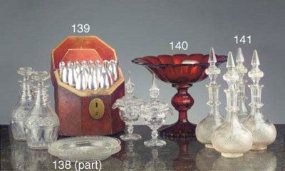 A set of four cut-glass decant