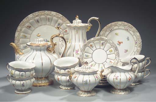 (26) A Meissen porcelain floral gilt coffee service