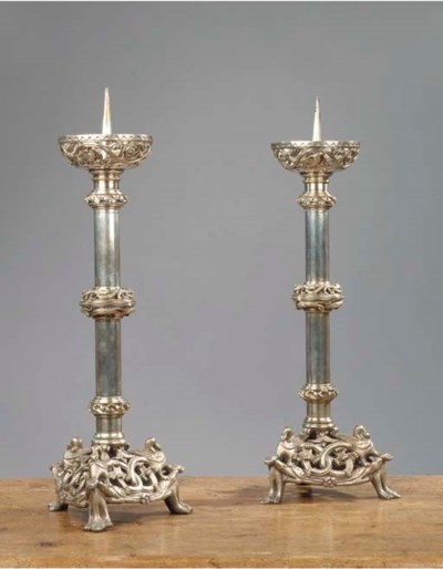 A pair of silvered brass altar